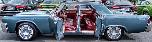 Doors open showing the leather interior of a 62 Continental