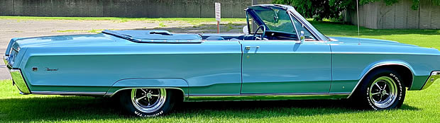 side view of a 68 Chrysler Newport convertible