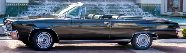 Side view of the 66 Imperial Crown convertible with the top down