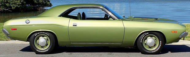 side view of a light green 73 Dodge Challenger