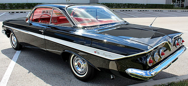 Rear view of a black 61 Impala Sport Coupe