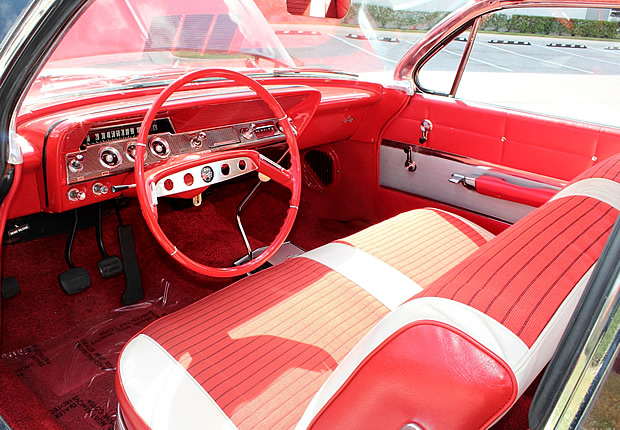 Red and white interior of a 1961 Chevy Impala sport coupe