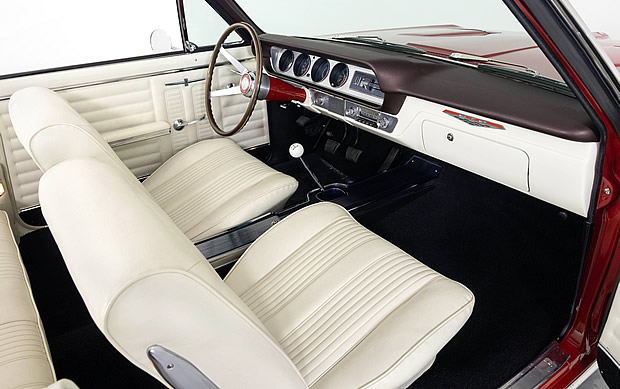 parchment bucket seat interior of a 1964 Pontiac GTO convertible