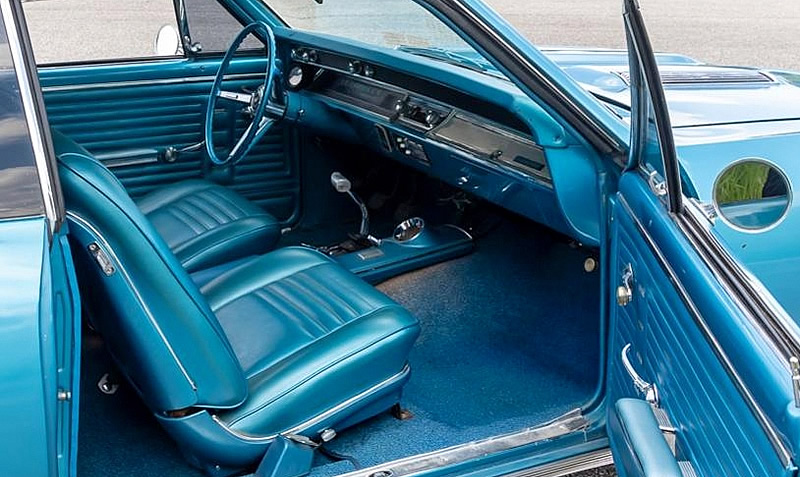 Gorgeous 67 Chevelle interior with optional Strato bucket seats and center console.