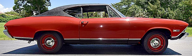 side view of a red 68 Chevy Chevelle SS396