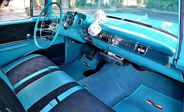 light turquoise vinyl and black and turquoise pattern cloth interior of a 57 Chevy Bel Air
