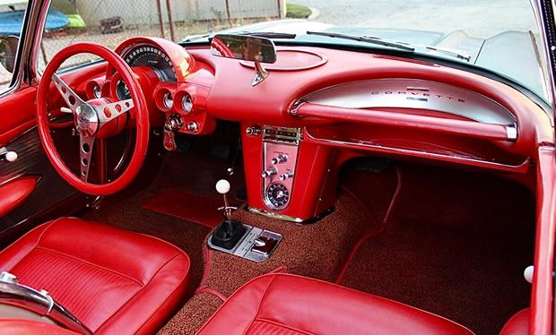 red interior of a 61 Corvette