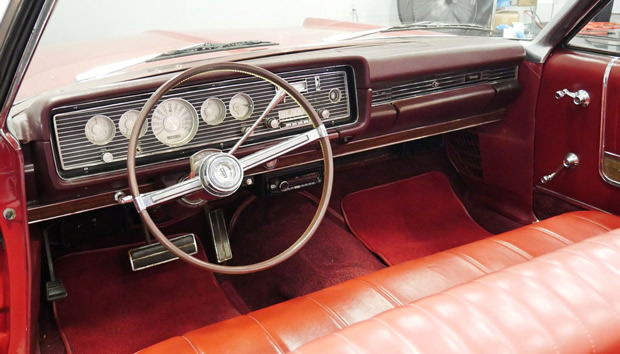 red vinyl interior of a 1966 Mercury Park Lane convertible