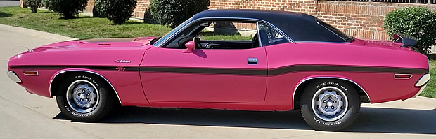 Side view of a 70 Dodge Challenger R/T in Panther Pink