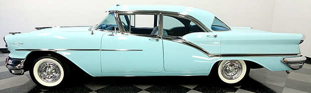 side view of a 57 Oldsmobile Ninety Eight 4-door Holiday hardtop