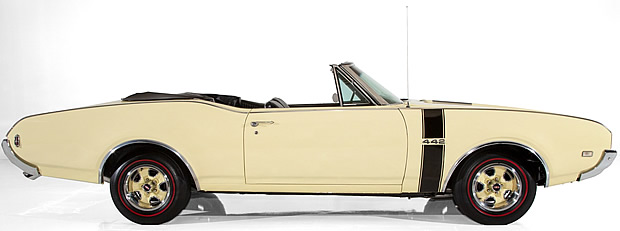 side view of a Saffron (yellow) 1968 Oldsmobile 442 convertible