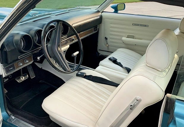 white vinyl interior of a 69 Torino GT