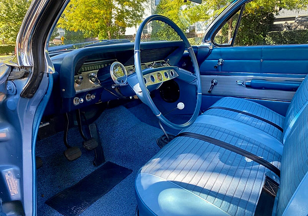 two-tone blue vinyl and cloth interior of a 1961 Chevy Impala