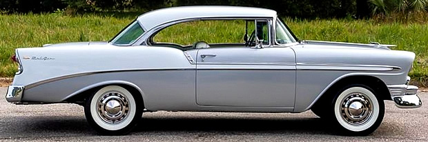 Side view of a 56 Chevy Bel Air in Inca Silver and Ivory Paint
