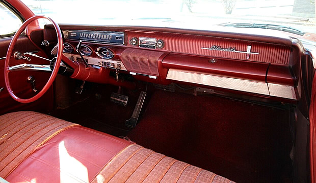 Futuristic dash and instrument panel of a 61 Olds 88