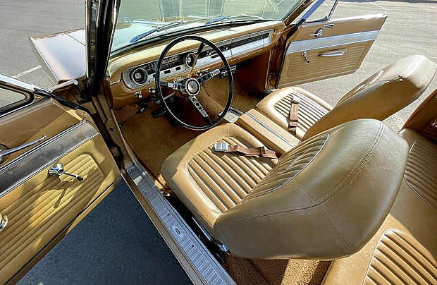 Gold bucket seat interior of a 64 Ford Falcon