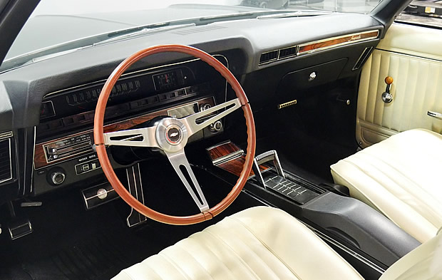 Parchment white bucket seat interior of a 69 Impala SS 427