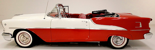 Side view of a 1955 Oldsmobile convertible with the top down