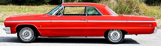Side view of a 1964 Chevrolet Impala SS in Riverside Red