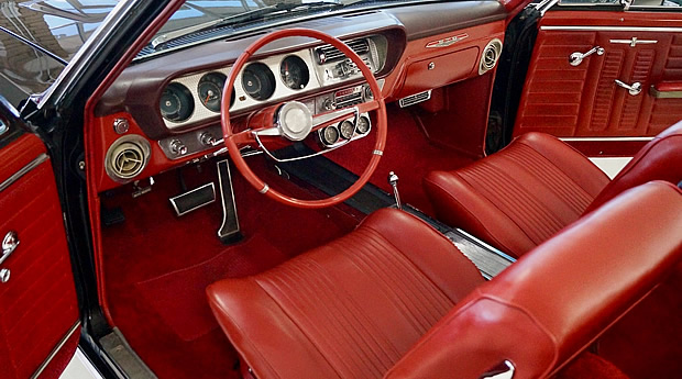 medium red bucket seat interior of a 1964 Pontiac GTO convertible