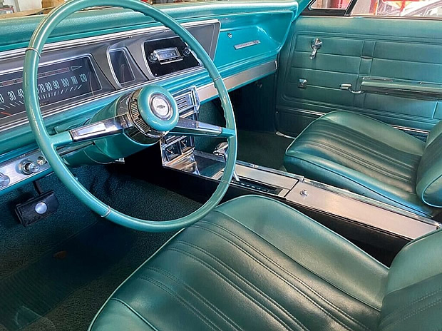 Bucket seat all-vinyl interior of a 1966 Chevy Impala SS